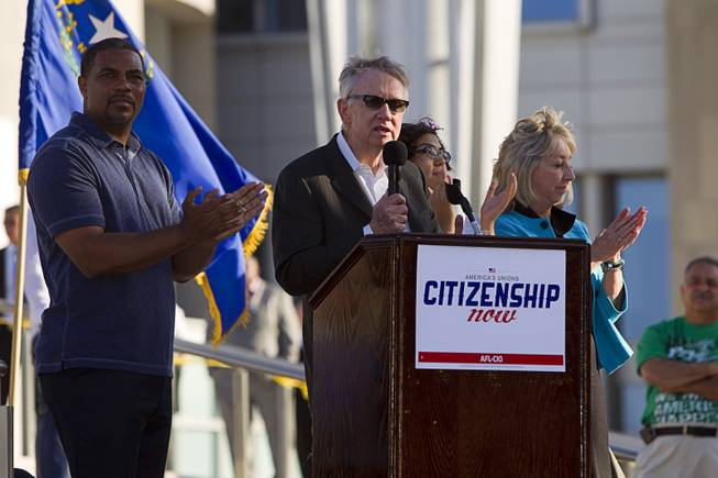 Senate Majority Leader Harry Reid (D-NV) is joined by Congressman Steven Horsford, left, and Congresswoman Dina Titus as he speaks during a May Day rally for comprehensive immigration reform in downtown Las Vegas Wednesday, May 1, 2013. The event started at the George Federal Building downtown, then marchers traveled south on Las Vegas Boulevard, finishing with a rally at St. Louis Square near the Stratosphere.