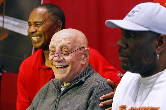 Coach Jerry Tarkanian and former players Robert Smith, left, and Eldridge Hudson, pose for photos during the announcement of the creation of The Jerry Tarkanian Legacy Project, which includes a statue of Tarkanian and his ubiquitous towel,  Wednesday, May 1, 2013.