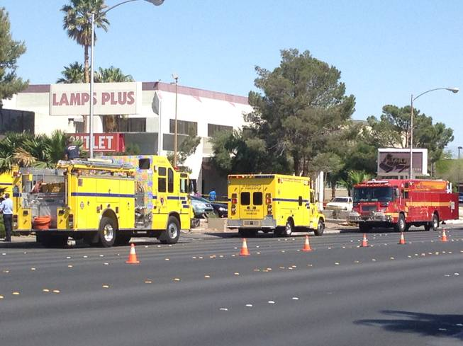 Fire trucks and an ambulance respond to a fire at a medical building near Sunrise Hospital and Medical Center on Wednesday, May 1, 2013.