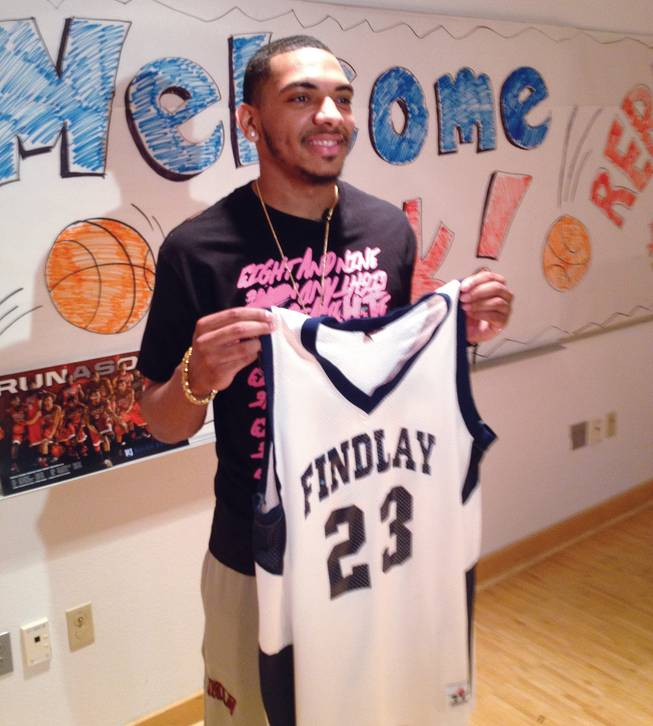 Former UNLV guard Anthony Marshall holds his jersey No. 23 from Clifford O. Findlay Middle School. The school retired his jersey May 1, 2013.