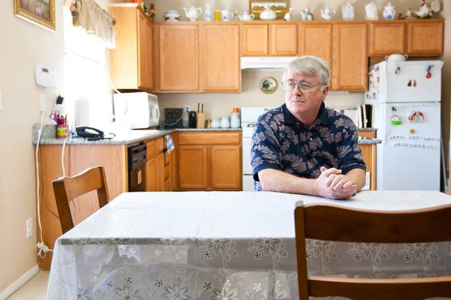 "Larry Brown, who strongly opposes immigration reform and ""amnesty"" for illegal immigrants and believes his identity and Social Security number were stolen by an illegal immigrant, sits frustrated at the government in his home in North Las Vegas Tuesday, April 30, 2013."