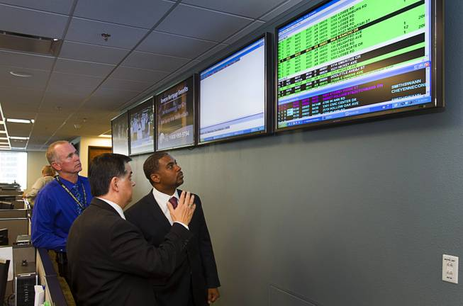 Congressman Steven Horsford (D-NV), right, takes a tour of the Southern Nevada Counter-Terrorism Center, also known as the Fusion Center, with Jim Owens, left, deputy chief of Metro's homeland security division, and Capt. Al Salinas, center director, at Metro Police Headquarters Thursday, May 2, 2013. Officials at the center are concerned that budget cuts that might negatively affect its operations.