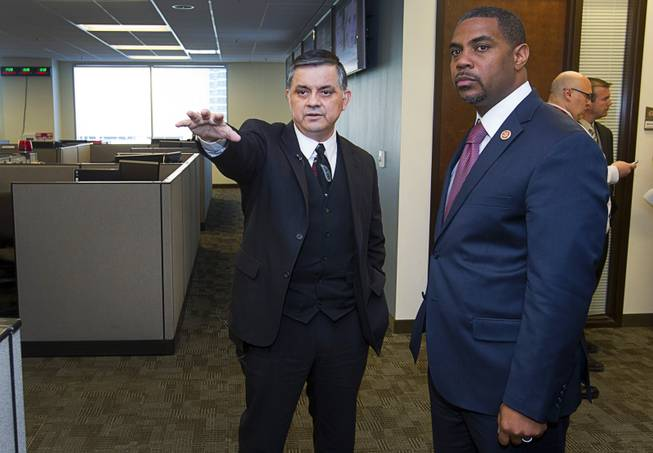 Capt. Al Salinas, left, gives a tour of the Southern Nevada Counter-Terrorism Center, also known as the Fusion Center, to Congressman Steven Horsford (D-NV) at Metro Police Headquarters Thursday, May 2, 2013. Officials at the center are concerned that budget cuts that might negatively affect its operations.