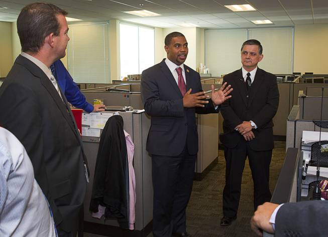 Congressman Steven Horsford (D-NV), center, talks with officials after a tour of the Southern Nevada Counter-Terrorism Center, also known as the Fusion Center, at Metro Police Headquarters Thursday, May 2, 2013. Officials at the center are concerned that budget cuts that might negatively affect its operations.