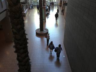 People are seen walking in the dark lobby of the Las Vegas Regional Justice Center during an afternoon power outage, Thursday, May 2, 2013.