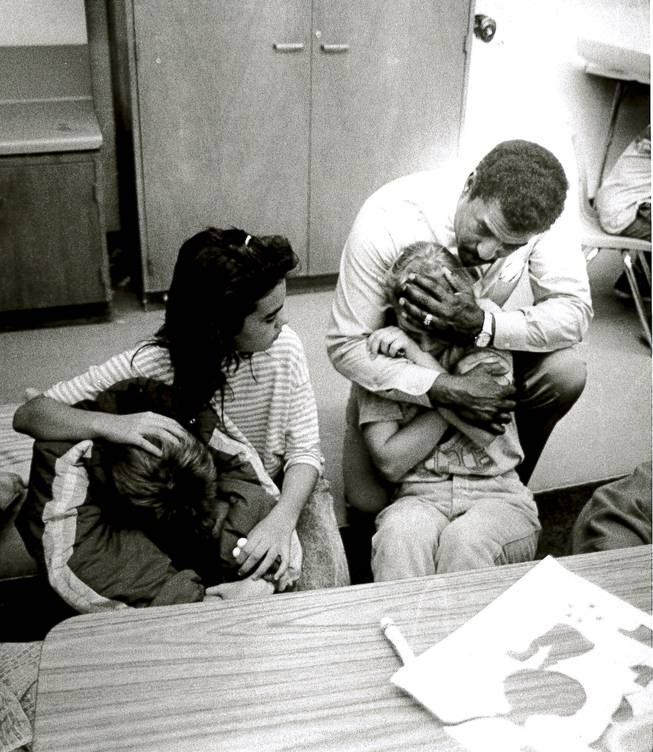 A teacher and student comfort students at Laura Dearing Elementary School who are visibly upset May 5, 1988, a day after two explosions destroyed PEPCON. Two people died and about 300 were injured in the blasts.