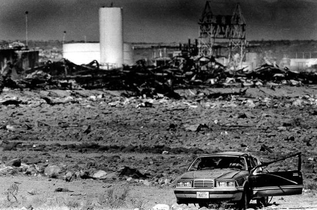 A car lies amid the rubble May 6, 1988, after two large explosions destroyed the Pacific Engineering Production Company of Nevada plant in Henderson on May 4, 1988. Debris rained down around the city, and the windows and doors of nearby homes were shattered by the incident.