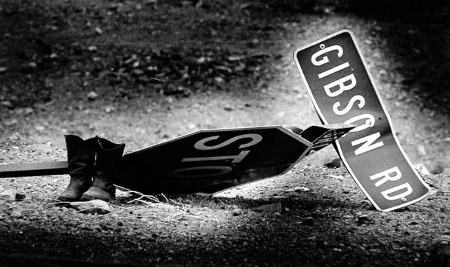 A stop sign, street signs and boots lay on the ground May 5, 1988, after the blasts at the Pacific Engineering Production Company of Nevada plant May 4, 1988. The plant was located at what is now Gibson Road and Wigwam Parkway. PEPCON eventually rebuilt in Utah.