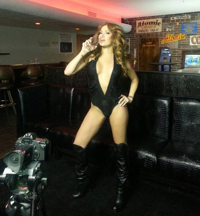 "A Playboy model is photographed at Atomic Liquors, 917 Fremont St. A group of models from Buenos Aires was in town Wednesday and Thursday, May 1 and 2, 2013, for a Playboy TV segment on ""secret spots"" in Las Vegas."