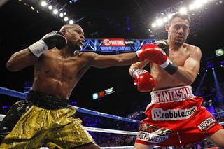 WBC welterweight champion Floyd Mayweather Jr., left, connects a punch on Robert Guerrero during their title fight at the MGM Grand Garden Arena Saturday, May 4, 2013.