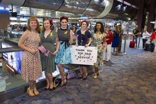 Members of Pinups for Patriots wait to welcome back World War II veterans after the first Las Vegas Honor Flight at McCarran International Airport Sunday, May 5, 2013. About 35 Southern Nevada veterans visited Baltimore and memorials in Washington D.C. Pinups for Patriots is a group that works with charities that support military causes.