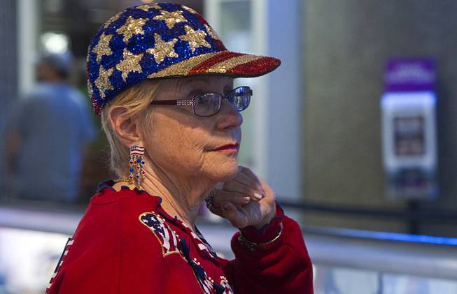 A woman, dressed in patriotic attire, waits to welcome back World War II veterans after the first Las Vegas Honor Flight at McCarran International Airport Sunday, May 5, 2013. About 35 Southern Nevada veterans visited Baltimore and memorials in Washington D.C.
