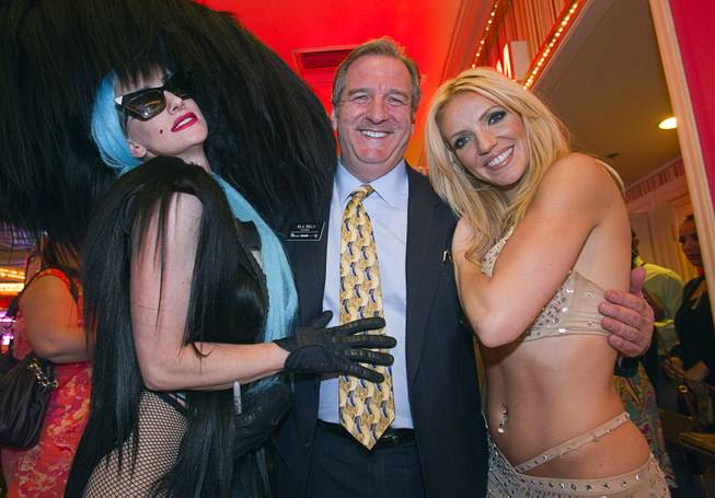 Flamingo President Rick Mazer poses with Lady Gaga (Kate Steele) and Britney Spears (Katie Murdock) after a special 30th anniversary performance of Legends in Concert at the Flamingo Showroom Monday, May 6, 2013.