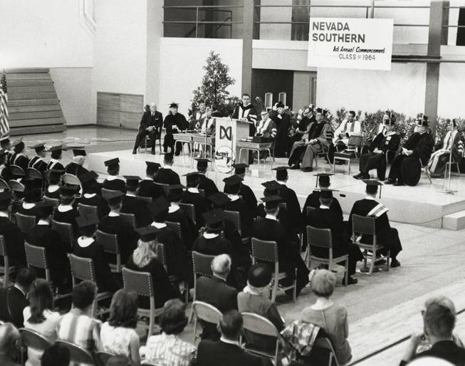 Nevada Gov. Grant Sawyer addresses the first graduating class at commencement in 1964, when UNLV was known as Nevada Southern University. 29 students graduated at the first commencement ceremony. (UNLV Special Collections)