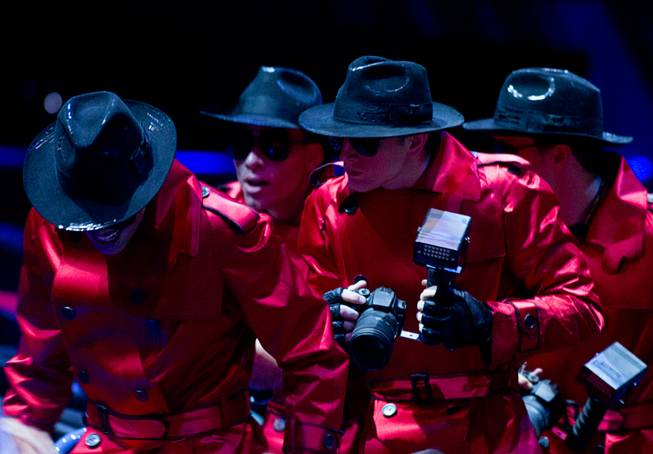 "Costumed paparazzi appear to be looking for celebrities in the audience during a sneak preview of ""Michael Jackson One"" at Mandalay Bay on Tuesday, May 7, 2013. The new show, by Cirque du Soleil and The Estate of Michael Jackson, is scheduled to hold an official premiere June 29."