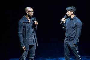 "Welby Altidor, left, director of creation, and Jamie King, writer and director, discuss ""Michael Jackson One"" by Cirque du Soleil before a sneak peek of the show at Mandalay Bay on Tuesday, May 7, 2013."