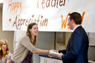 Charity Kline accepts a $750-valued gift certificate to the Teacher Exchange for classroom resources from Terry Kennedy, CEO of Appreciation Financial, at Vegas Verdes Elementary School in Las Vegas Tuesday, May 7, 2013.