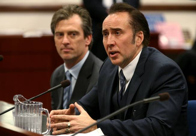 Actor Nicholas Cage testified in support of a bill proposing tax incentives to filmmakers at the Legislative Building Carson City, Nev., on Tuesday, May 7, 2013. Proponents of the measure say it will bring jobs and revenue to the state. Cage's agent Michael Nilon is at left.