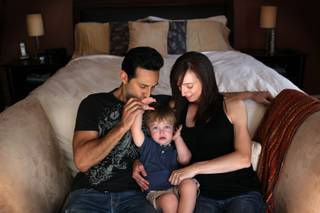 Dani Wylie, who is five months pregnant, sits with her partner Jason Martinez and their 22-month-old son Maxwell Martinez at their home in Henderson on Wednesday, May 8, 2013. Wylie is a dancer and the dance team captain in