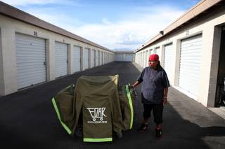 Erma Hernandez, who has been homeless in Las Vegas for three years, stands with her EDAR housing unit on Wednesday, May 8, 2013, outside her storage unit on Bonanza Road in Las Vegas. Though she has been sleeping in the EDAR (Everyone Deserves a Roof), a compact portable housing unit on wheels, for the past month or so, she will not sleep in it tonight for fear that Metro Police will confiscate it from her. The EDAR was given to her by Project Aqua, a local homeless advocacy group.