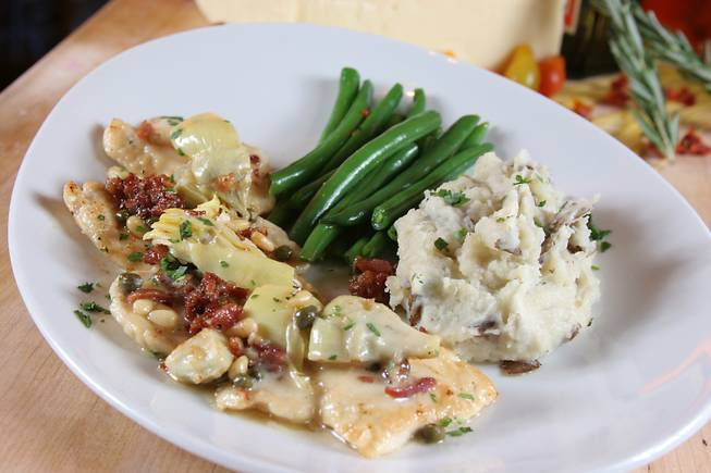 Chicken scaloppine sautéed with artichoke hearts, pancetta, capers, pine nuts and lemon butter sauce with green beans and garlic mashed potatoes served for Mother's Day at Trevi inside the Forum Shops at Caesars Palace.