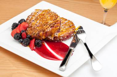 Caribbean French Toast made with piña colada mix, fresh shaved coconut and served with a raspberry coulis and fresh berries will be served for Mother's Day at Central Michel Richard at Caesars Palace.