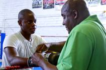 Mike McCallum Jr., a Silverado High School student, listens to his father during a workout at Johnny Tocco's Boxing Gym Thursday, May 9, 2013. Mike ...