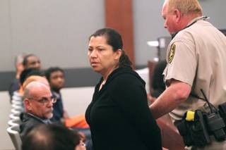 Ana Ocegueda is lead away in handcuffs after being sentenced for embezzling over $500,000 from Tom Clift and his company N.A.C. Electric Thursday, May 9, 2013.