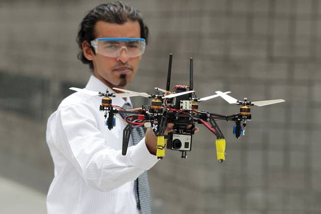 Senior mechanical engineering student Muhammad Ayub demonstrates the Variable Pitch Quad Rotor Kopter during the UNLV College of Engineering Senior Design Competition on Thursday, May 9, 2013 at the Cox Pavilion in Las Vegas.