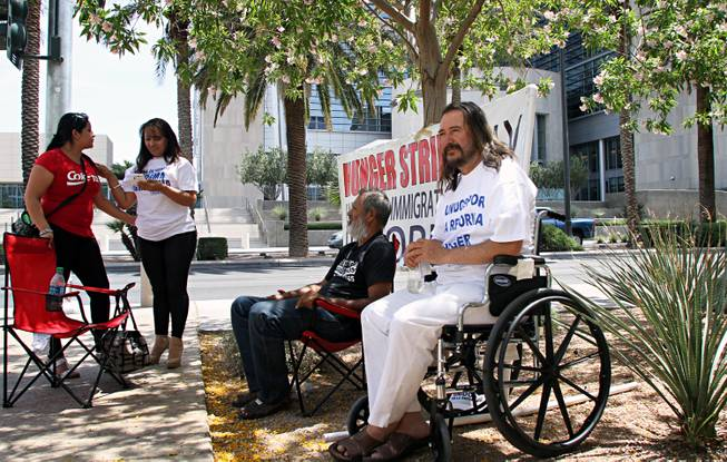 Salvador Zamora, 51, has staged a one-man hunger strike across from the Lloyd George Federal Building in downton Las Vegas to support the push for immigration reform. As of May 9, 2013, Zamora had gone 30 days without eating. He drinks eight to 10 bottles of water a day, and five bottles of water mixed with a little bit of lemon juice and two spoon fulls of honey. He has people with him at most time in case of a medical emergency or to help when he is too weak to walk.