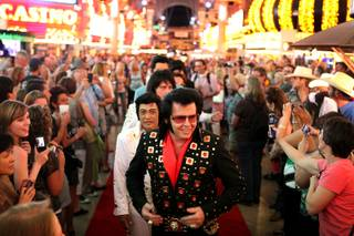 Sean Martin of Arcadia, Calif. waits with other Elvis tribute artists to walk the red carpet during the Las Vegas Ultimate Elvis Tribute Artist Contest on Friday, May 10, 2013 at the Fremont Street Experience in downtown Las Vegas.