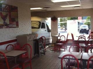 A van crashed through the front entrance of a KFC Friday after a collision with a pickup truck outside the restaurant on Friday afternoon, May 10, 2013.