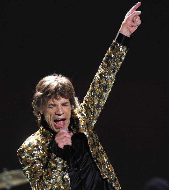Mick Jagger sings as The Rolling Stones perform during their show at MGM Grand Garden Arena on Saturday, May 11, 2013.