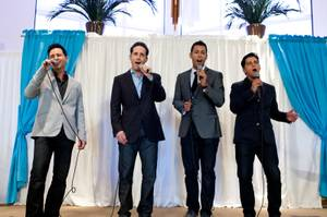 The Jersey Boys, left to right, Travis Cloer, Jeff Leibow, Buck Hujabre and Deven May, perform during a fundraiser to benefit trombonist Mike Turnbull, who is recovering from stage-four thyroid cancer, at New Song Anthem Church Saturday, May 11, 2013.