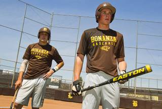 Brett Doyle, left, and Chris Dunn wait for a turn at bat during practice at Bonanza High School Monday, May 13, 2013. Bonanza is the surprise team in the state tournament, upsetting the seven-time state champion Bishop Gorman High School twice in last week's double elimination Sunset Regional event.
