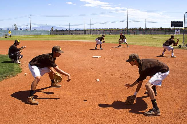 Players run a drill during practice at Bonanza High School Monday, May 13, 2013. Bonanza is the surprise team in the state tournament, upsetting the seven-time state champion Bishop Gorman High School twice in last week's double elimination Sunset Regional event.