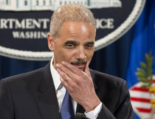 Attorney General Eric Holder pauses during a news conference at the Justice Department in Washington, Tuesday, May 14, 2013. Holder said he's ordered a Justice Department investigation into the Internal Revenue Service's targeting of conservative groups for extra tax scrutiny.