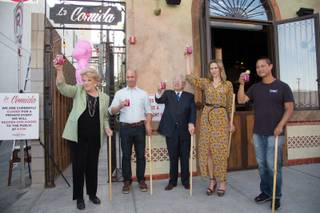 From left: Las Vegas Mayor Carolyn Goodman, owner Michael Morton, Councilman Bob Coffin, owner Jenna Morton and Tony Hsieh raise their drinks to a toast at the La Comida restaurant's grand opening on Thursday, May 17, 2013.