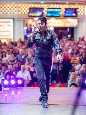 Chad Collins of Las Vegas competes in the second day of the Las Vegas Ultimate Elvis Tribute Artist Contest on Saturday, May 11, 2013. Collins won the competition.