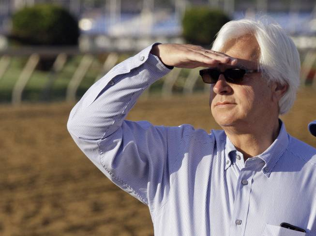 Hall of Fame trainer Bob Baffert looks for his Preakness Stakes entrant Governor Charlie during a morning workout at Pimlico Race Course on Friday, May 17, 2013, in Baltimore. The Preakness Stakes horse race is scheduled for Saturday.