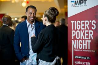 Tiger Woods and World Poker Tour's Kimberly Lansing at Tiger's Poker Night sponsored by WPT at Moorea Beach Club at Mandalay Bay on Friday, May 17, 2013.