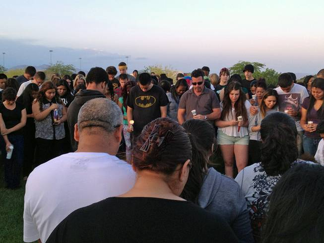 A candlelight vigil is held Friday, May 17, 2013, in remembrance of Bonanza High School freshman Marcos Vincente Arenas, who was killed when he was run over by an SUV driven by thieves who had targeted the teen.