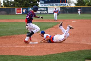 Bishop Gorman's Nick Gates tags the base to get out Coronado's Michael Maiello during the Division I State Championship game at William R. Morse Stadium at the College of Southern Nevada Saturday, May 18, 2013. The Cougars won 7-4 against the defending champion Gaels.