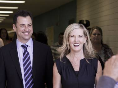 "Jimmy Kimmel of ABC's ""Jimmy Kimmel Live"" and Clark High School Principal Jill Pendleton head toward a ceremony area before a ribbon cutting at Clark High School to officially open the Jimmy Kimmel Technology Center on Saturday, May 18, 2013."