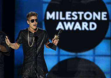 Justin Bieber accepts the Milestone Award during the 2013 Billboard Music Awards at MGM Grand Garden Arena on Sunday, May 19, 2013.