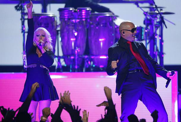 Musicians Pitbull and Christina Aguilera perform during the 2013 Billboard Music Awards at the MGM Grand Garden Arena Sunday, May 19, 2013.