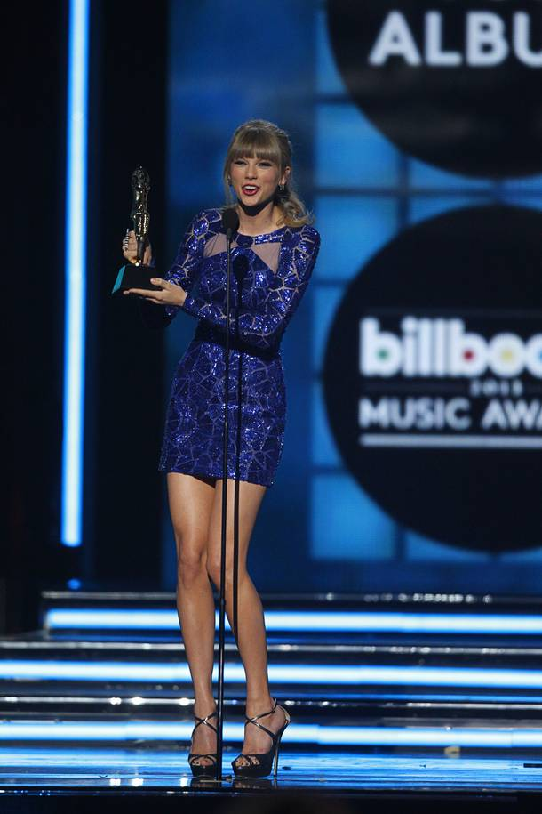 Singer Taylor Swift accepts the award for Top Billboard 200 Album during the 2013 Billboard Music Awards at the MGM Grand Garden Arena Sunday, May 19, 2013.