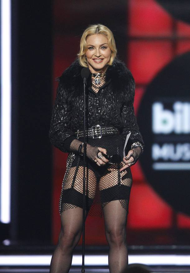 Madonna accepts the Top Touring Artist award, which recognizes the highest grossing concert touring act of the year, for her 2012 MDNA tour during the Billboard Music Awards at the MGM Grand Garden Arena Sunday, May 19, 2013. Madonna's MDNA tour grossed over $305 million from 88 sold-out shows in front of an audience of 2.2 million.