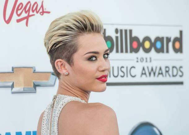 Miley Cyrus arrives at the 2013 Billboard Music Awards at MGM Grand Garden Arena on Sunday, May 19, 2013.