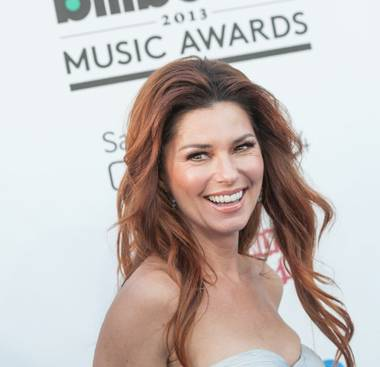 Canadian country pop superstar Shania Twain took on the role of a redheaded Grecian goddess when she wore a stunning strapless, bare-shouldered, ...